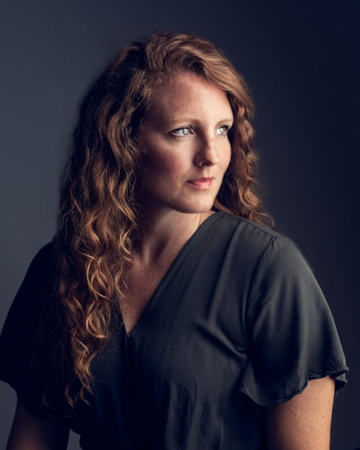 Studio portrait of red head woman