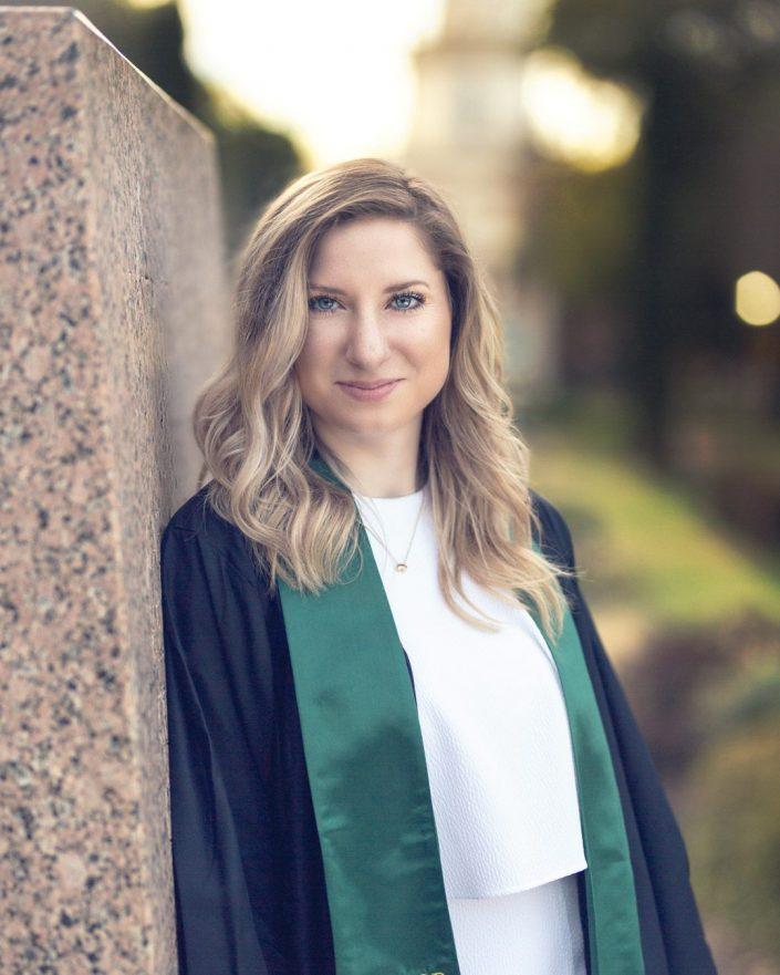 Portrait of woman in graduation robe